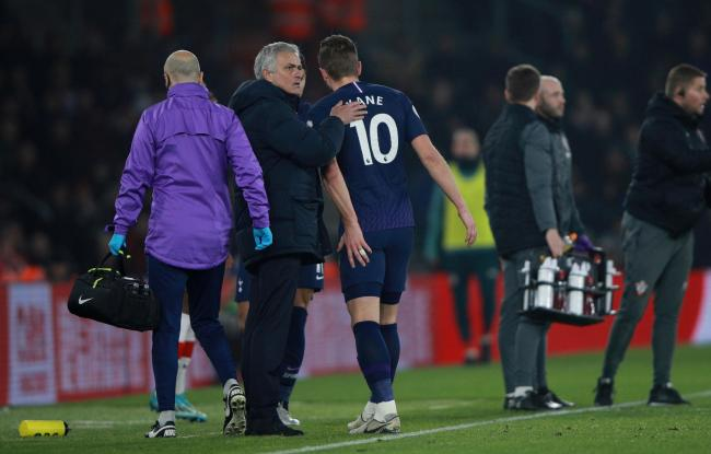 Harry Kane holds his hamstring as he goes off. Picture: Action Images