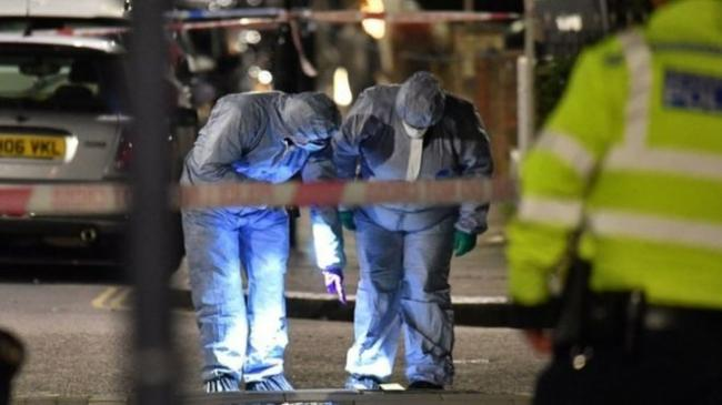 Forensic teams were seen working at the murder scene on Charteris Road, near Finsbury Park