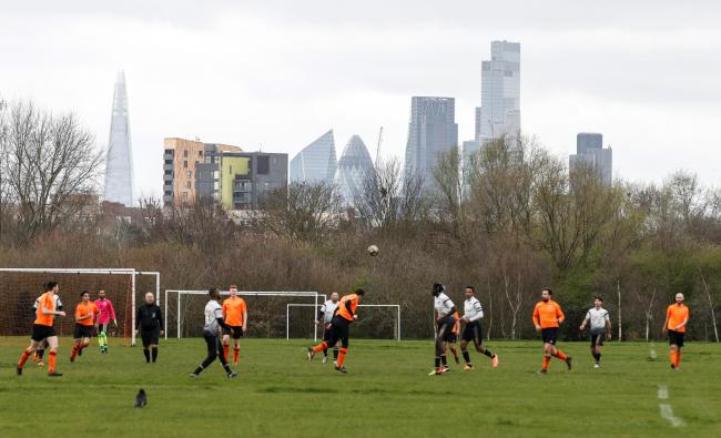 Men play park football at Hackney Marshes in London. Picture: Action Images