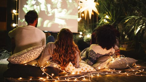 Enfield Independent: Sit back and relax with a projector and outdoor screen. Credit: Getty Images / M_A_Y_A