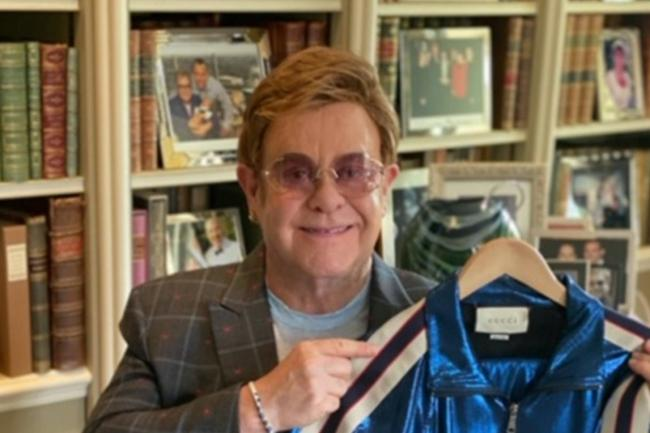 Sir Elton John with the Gucci tracksuit