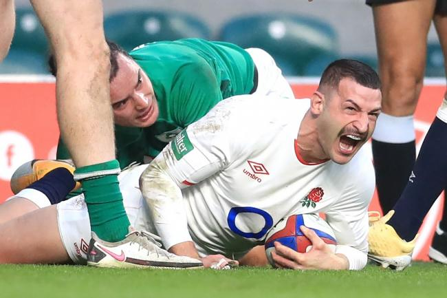 England's Jonny May celebrates scoring against Ireland at Twickenham