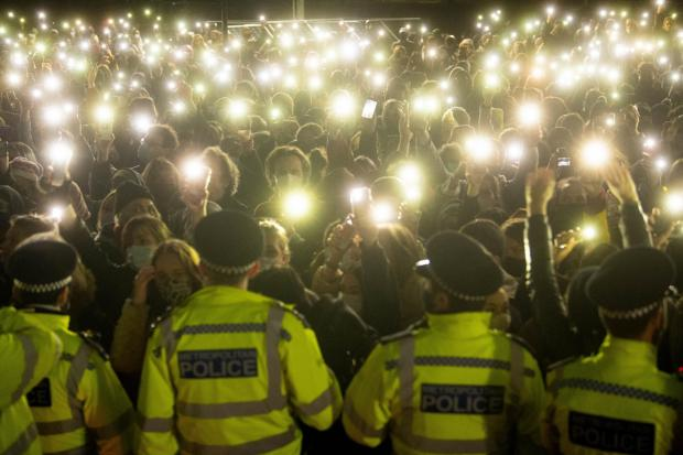 Enfield Independent: People in the crowd turn on their phone torches as they gather in Clapham Common, London, for a vigil for Sarah Everard