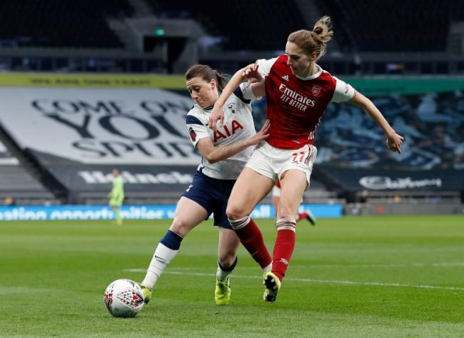 Arsenal's Vivianne Miedema in action with Tottenham Hotspur's Lucy Quinn Picture: Action Images