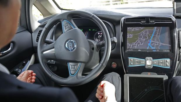 Enfield Independent: Self-driving cars enabling drivers to take their eyes off the road and their hands off the wheel could be permitted on UK motorways later this year (Philip Toscano/PA)