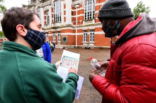 Enfield Independent: A volunteer handing out a leaflet