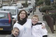 Sam, with his mother and two brothers, at the start of the sponsored walk