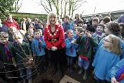 Celebration: Scouts and Beavers herald the creation of their new base as Mayor Cllr Jayne Buckland checks on progress at the derelict site and plants a ceremonial tree