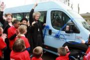 West Lea Special School celebrates its new minibus presented by Queen rocker Brian May and actress Anita Dobson