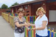 Headteacher of Russett House School Julie Foster collecting the donation from Winchmore Hill Bowls Club
