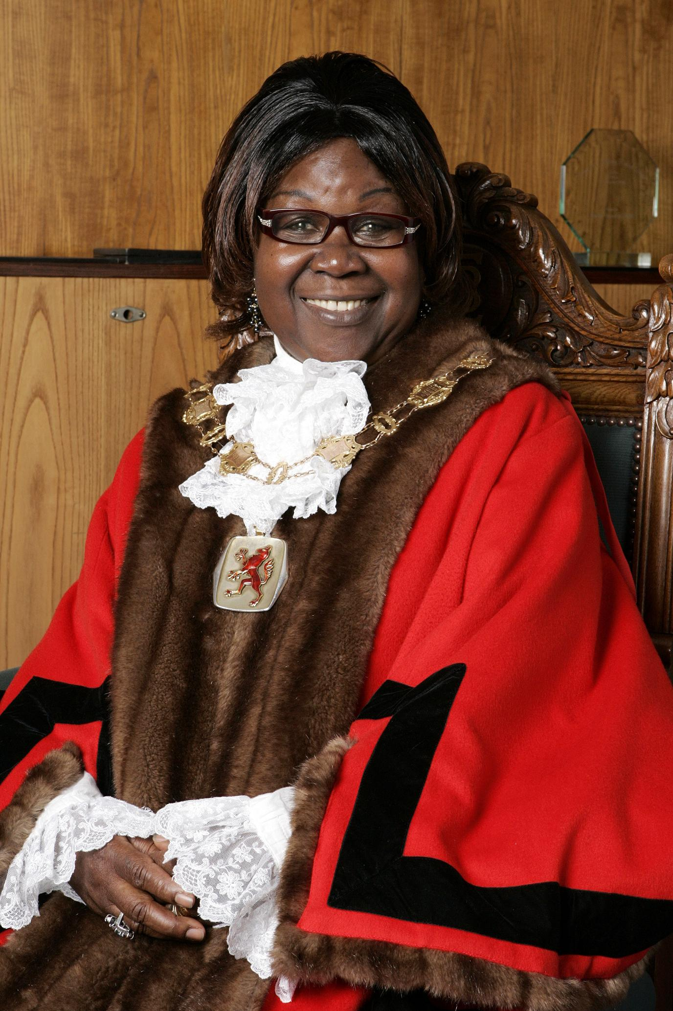 The new Mayor sits in her formal red robes.