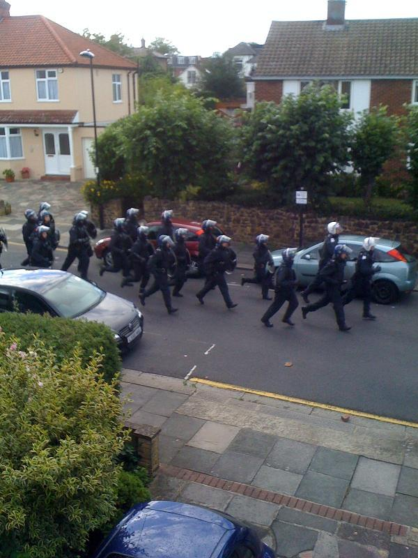 Clashes between rioters and police in Enfield Town
