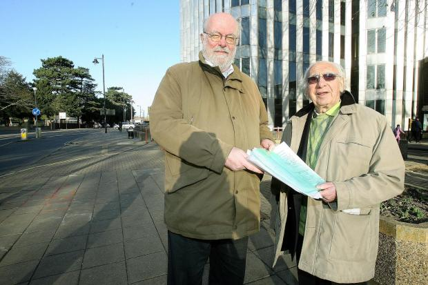 Councillor Chris Bond with campaigner Monty Meth holding the anti-spitting petition