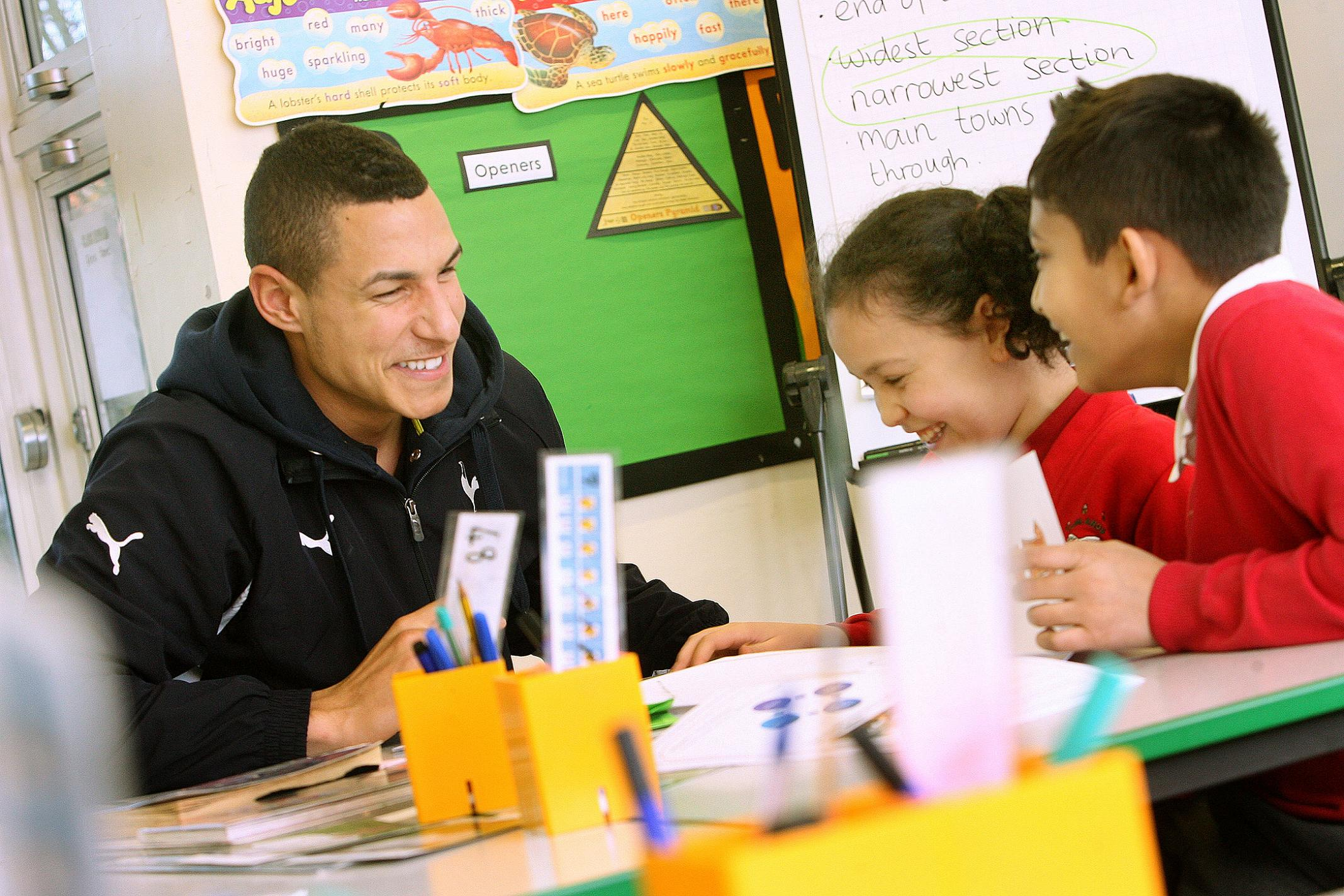 Jake Livermore with Year 5 pupils Aysa Harris and Rayyan Hoque.