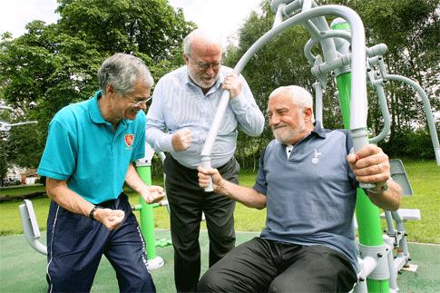 Friends of Broomfield Park chairman Laki Marangos tries out the gym, encouraged by committee member Tony Elliott and Cllr Bond.