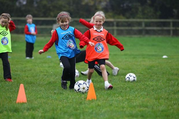 Children enjoy a free football session