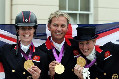 Showjumping team Charlotte Dujardin, Carl Hester and Laura Bechtolsheimer after winning Olympic Gold