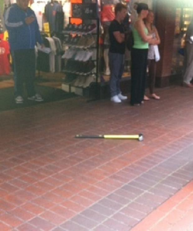 A sledgehammer was left on the floor outside the jewellers