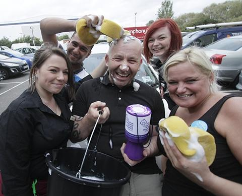 Staff washing cars for the good cause