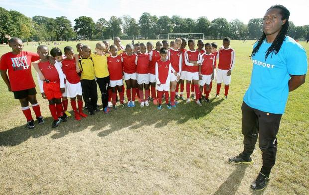 Club secretary Tim Aleshe with a group of young players