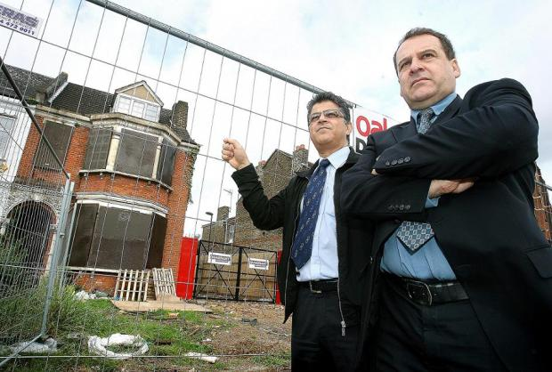 Cllr Oykener (left) and Mr Carter (right) in front of a Green Lanes property signed up to the scheme