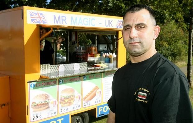 Fevzi Vedat outside his Mr Magic UK stall in Pymmes Park in Edmonton