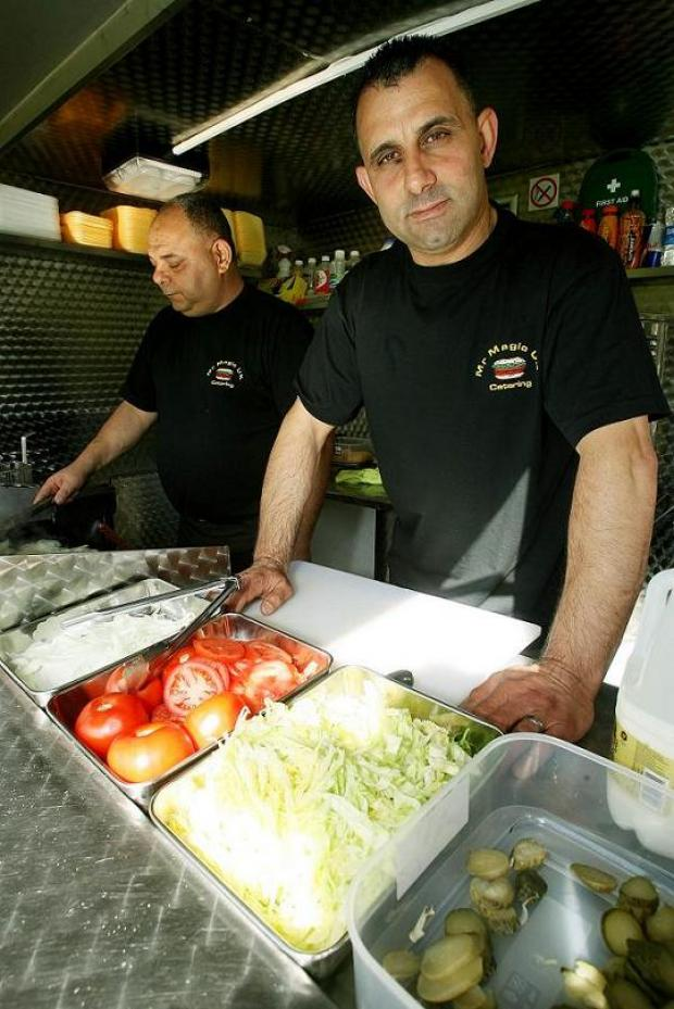 Enfield Independent: Fevzi Vedat working in his burger van in Pymmes Park Mr Magic UK