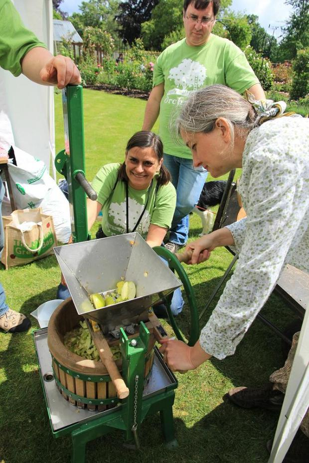 Trying out an apple press during last year's event