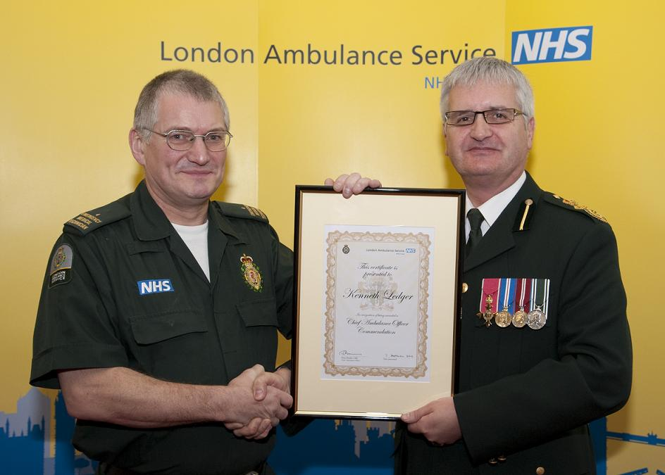Ken Ledger (left) receiving his award on Saturday