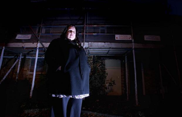 Mother Kathleen Carter outside her home devastated by fire in January