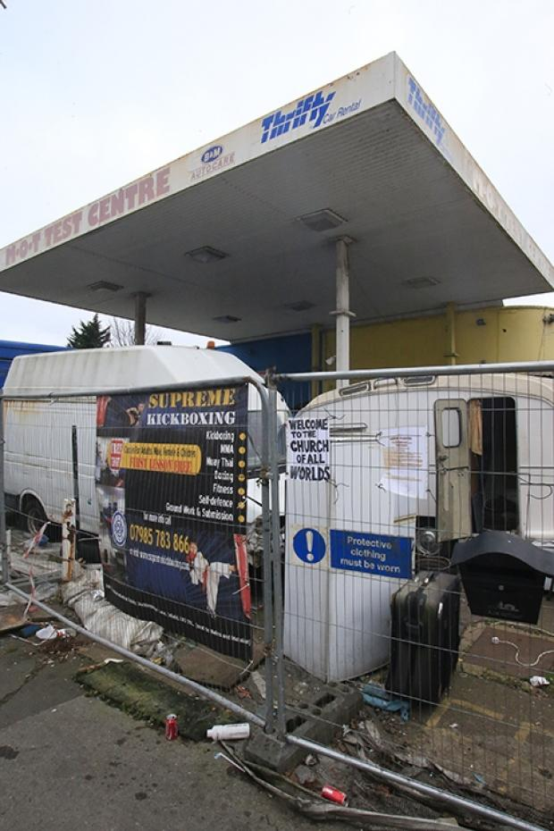 People have been squatting in the derelict petrol station for three years