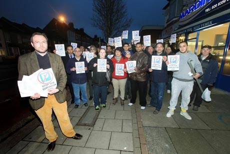 Councillor Henry Lamprecht with traders protesting against the council's parking plans