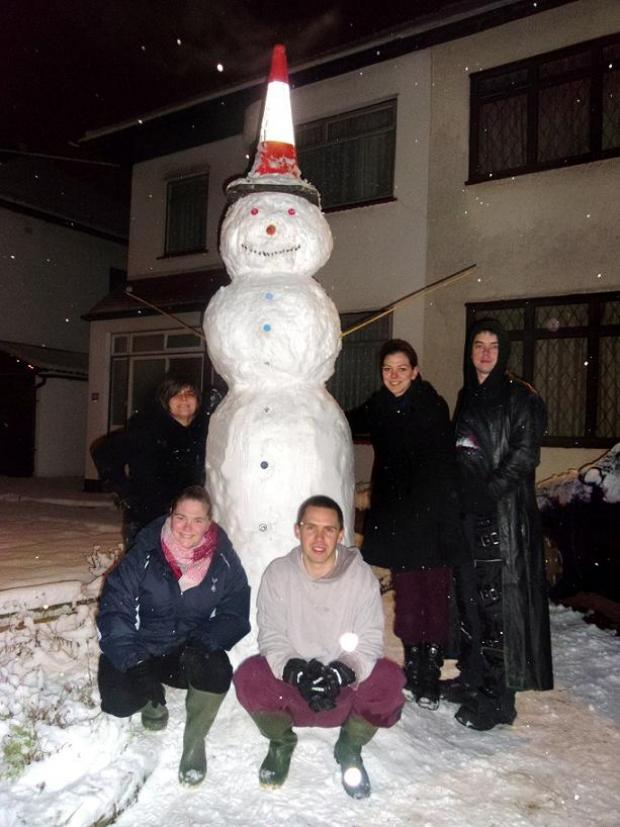 Caroline Regan, 27, Hollie Brock, 25, Ian Garner, 24, Jaime Brock, 22, and Dominic Taggart, 28, by Enfield's super snowman