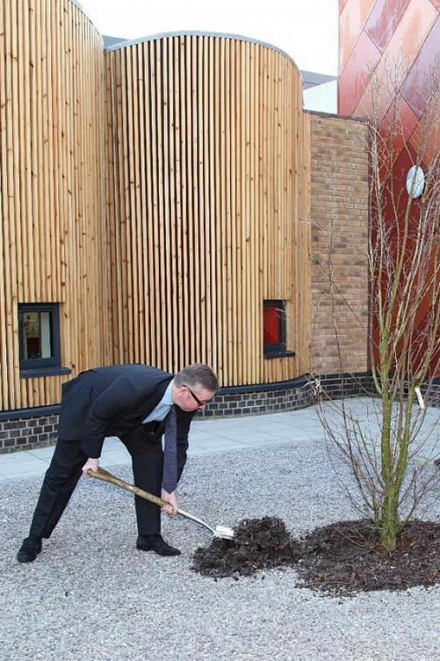Michael Gove planting a commemorative tree at Woodpecker Hall Primary Academy