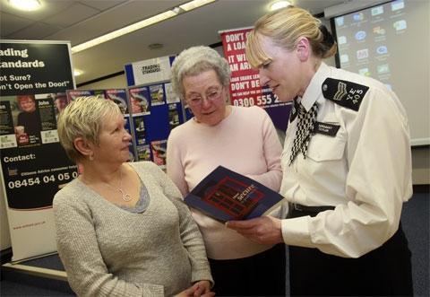 Sergeant Lorna Taylor discussing crime prevention with visitors