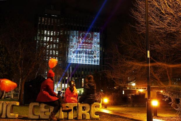 Passers-by stopped to watch the council's HQ lit up on Thursday
