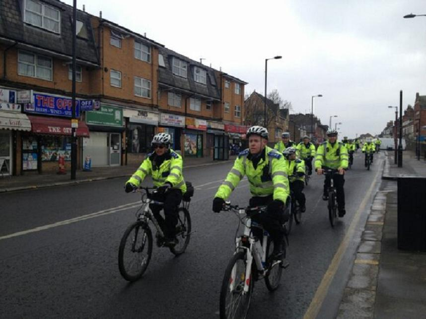 Police on their way to a street briefing earlier today