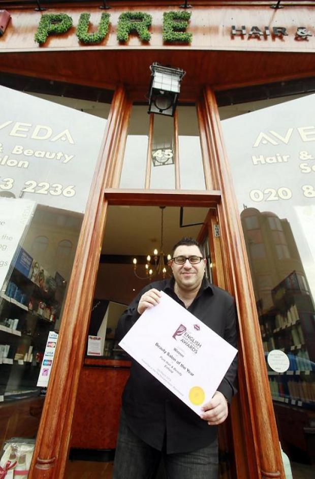 Tas Panteli with his winners certificate outside Pure Hair and Beauty