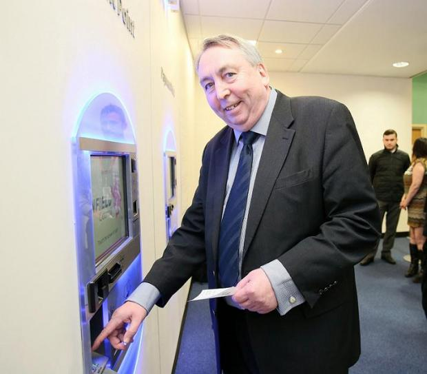 Councillor Andrew Stafford with the new autopay machines