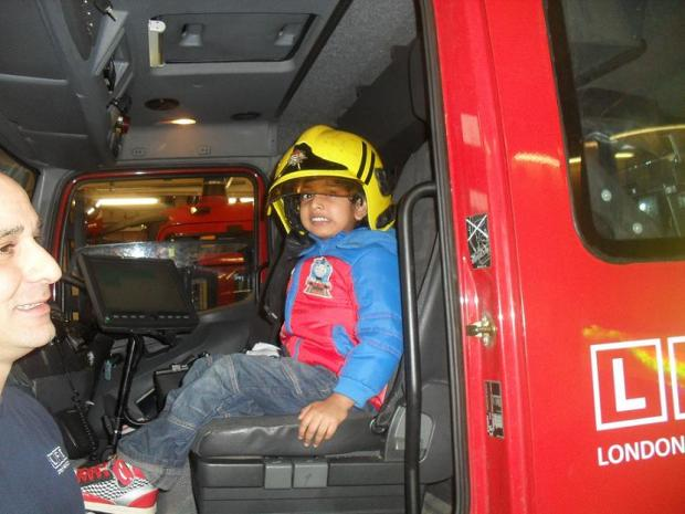 Aneesh Vundru learning tricks of the trade from fireman