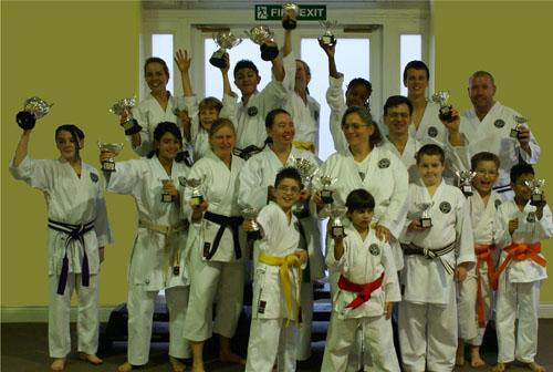 Members of North London Shotokan Karate Club are pictured with their haul of trophies