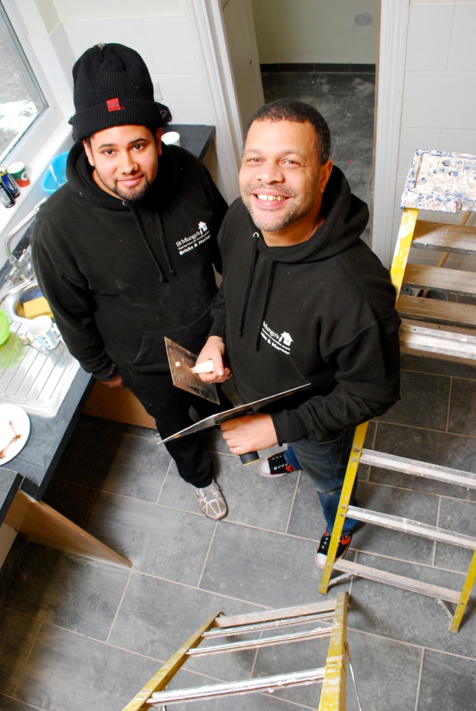 Leroy (left) and Ian (right) from Bricks and Mortar put the finishing touches to St Mungo's five bed property in Enfield