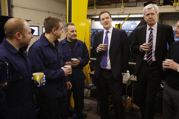 Enfield Independent: Chancellor George Osborne with Enfield North MP Nick de Bois and staff at Ridgeway Garages