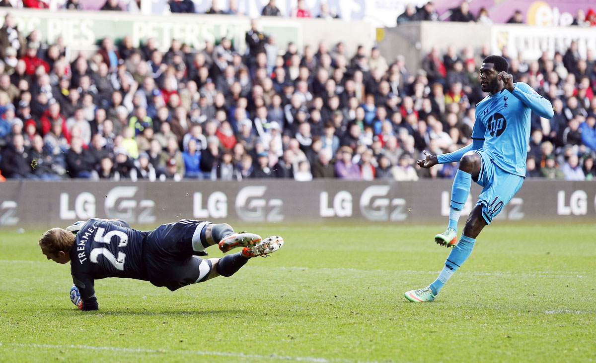 Emmanuel Adebayor scores Spurs' third goal. Picture: Action Images