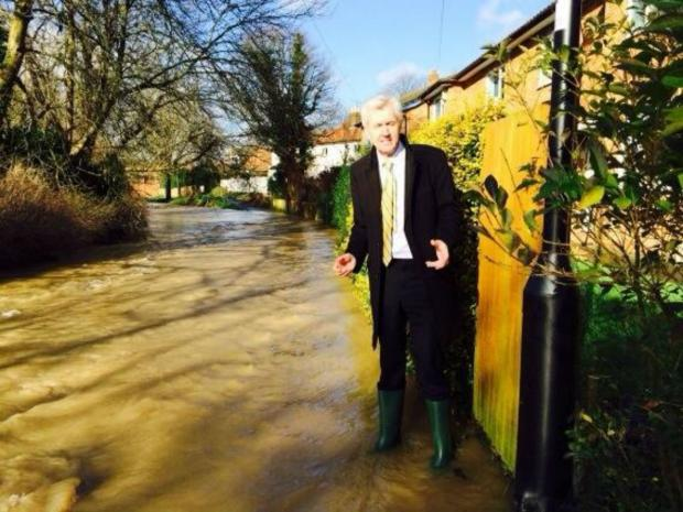 Picture tweeted by Enfield North MP Nick de Bois where brook has flooded