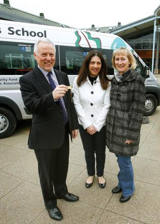 Bruce Goddard, Maria Zavros and Jayne Poole with the new minibus at Highlands School