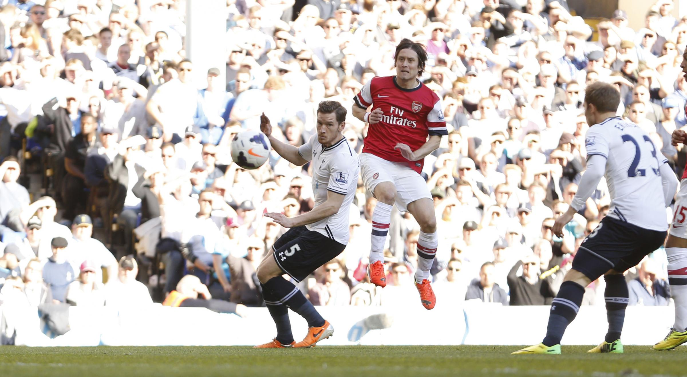 Tomas Rosicky's second minute wonder strike was enough to decide the end-to-end derby
