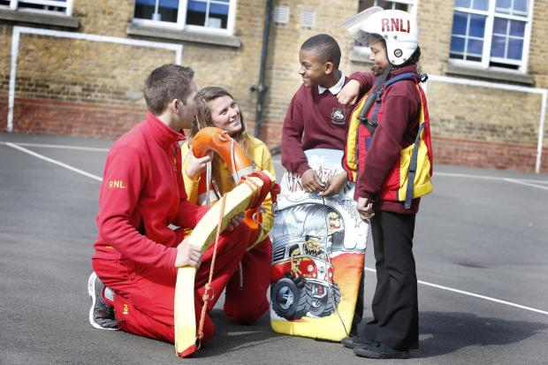 Lifeguards with pupils at Southbury School