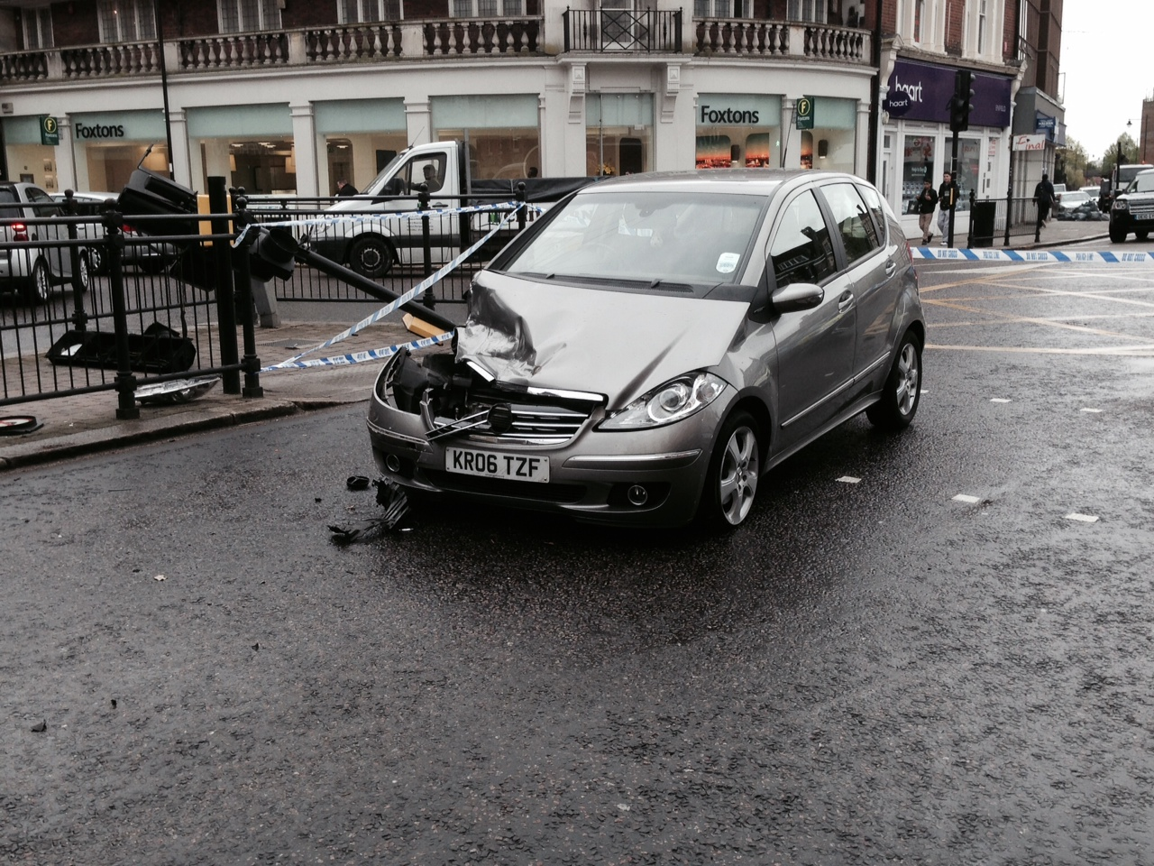 The mercedes which collided with a van which in turn caused a traffic light to fall on a woman