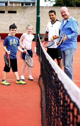 Coach Neil Bamford with Peter Wilson and Oliver, eight, and Isabella, ten
